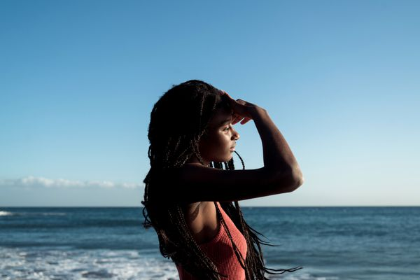 woman natural hair ocean
