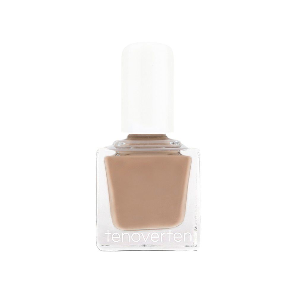 Cocoa brown nail polish on a white background.