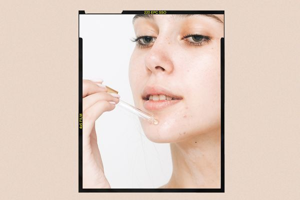 Woman applying a serum to her chin