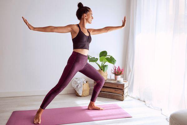 woman doing yoga in light room