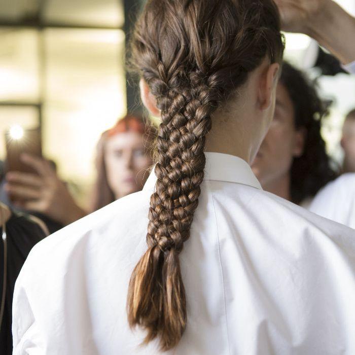 braids: woman with big braid at Jil Sander