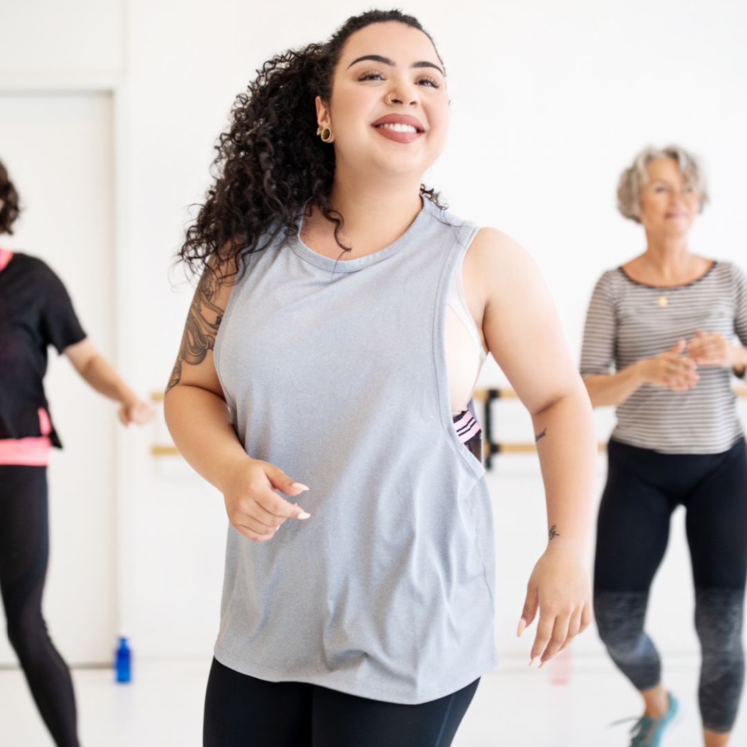 Woman smiling during exercise class