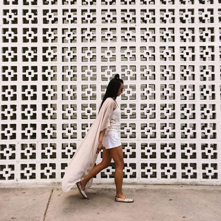 person walking along sidewalk