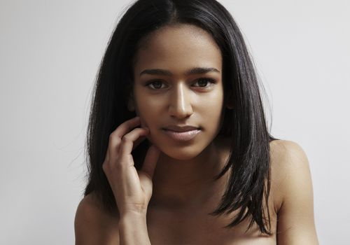 Black woman with straight, permed hair