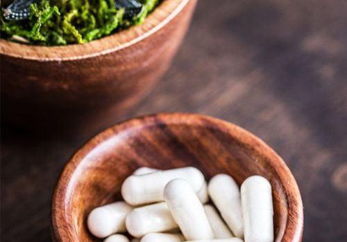 wooden bowl of supplements