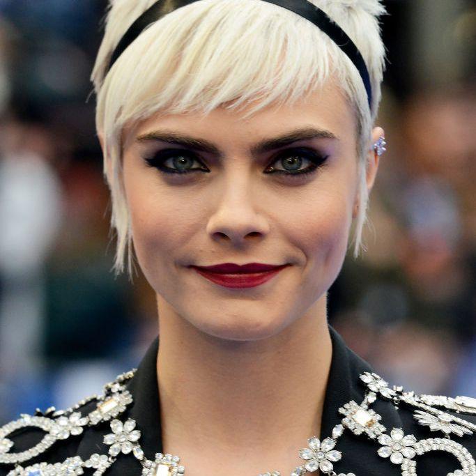 Cara Delevingne platinum pixie with headband