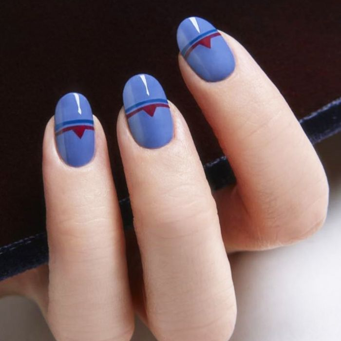 Blue geometric manicure with maroon details