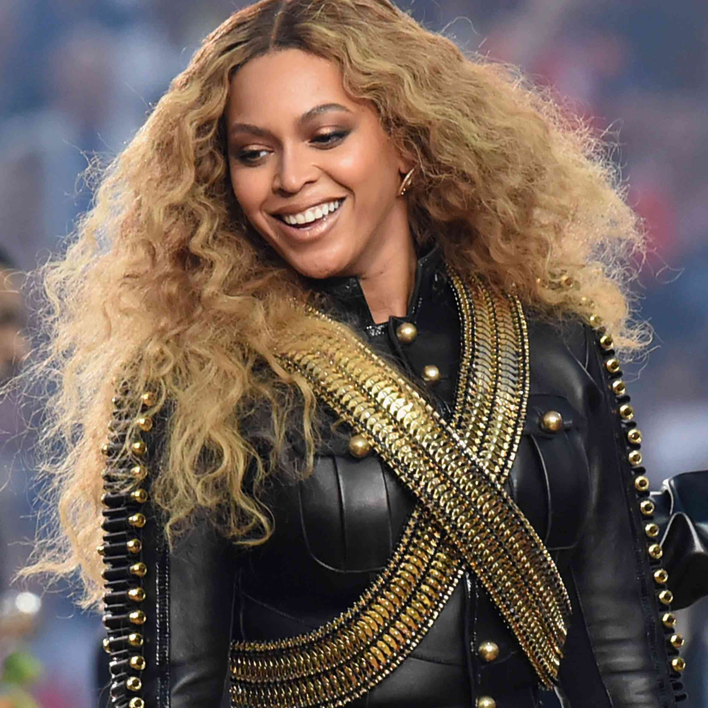 Beyonce in leather jacket and curly hair