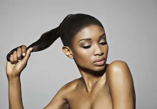 Black woman with sleek, straight ponytail