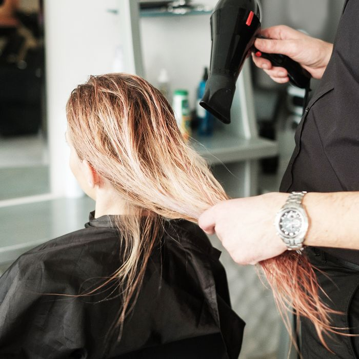 Does blow-drying your hair damage it?