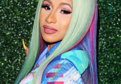 Cardi B wearing green, purple, and blue wig