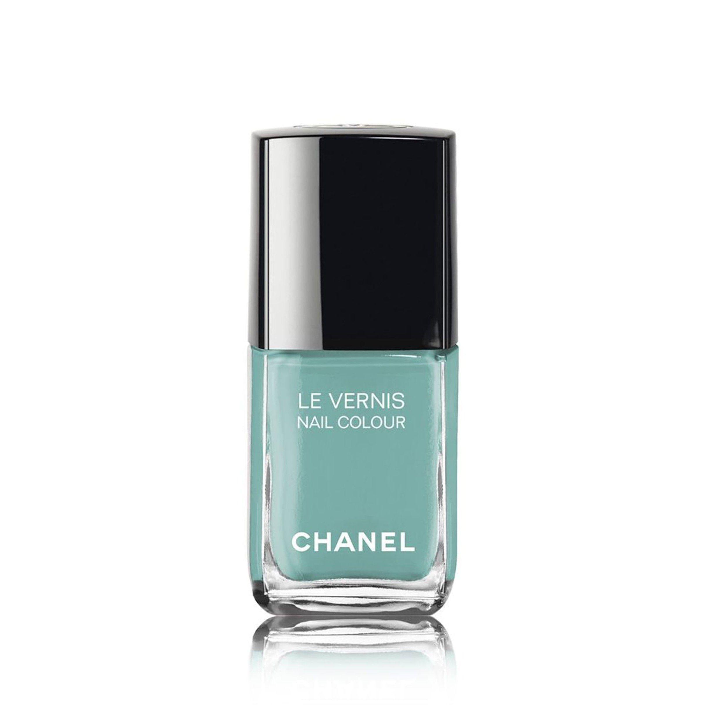 Bottle of greenish blue nail polish on a white background.