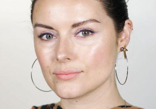 Katie Jane Hughes wearing blue eyeliner