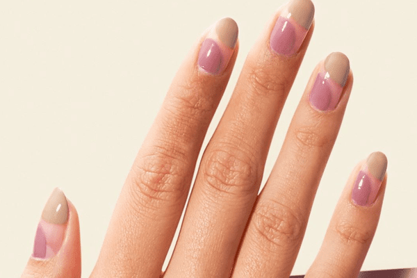 pink and beige nail design on oval nails