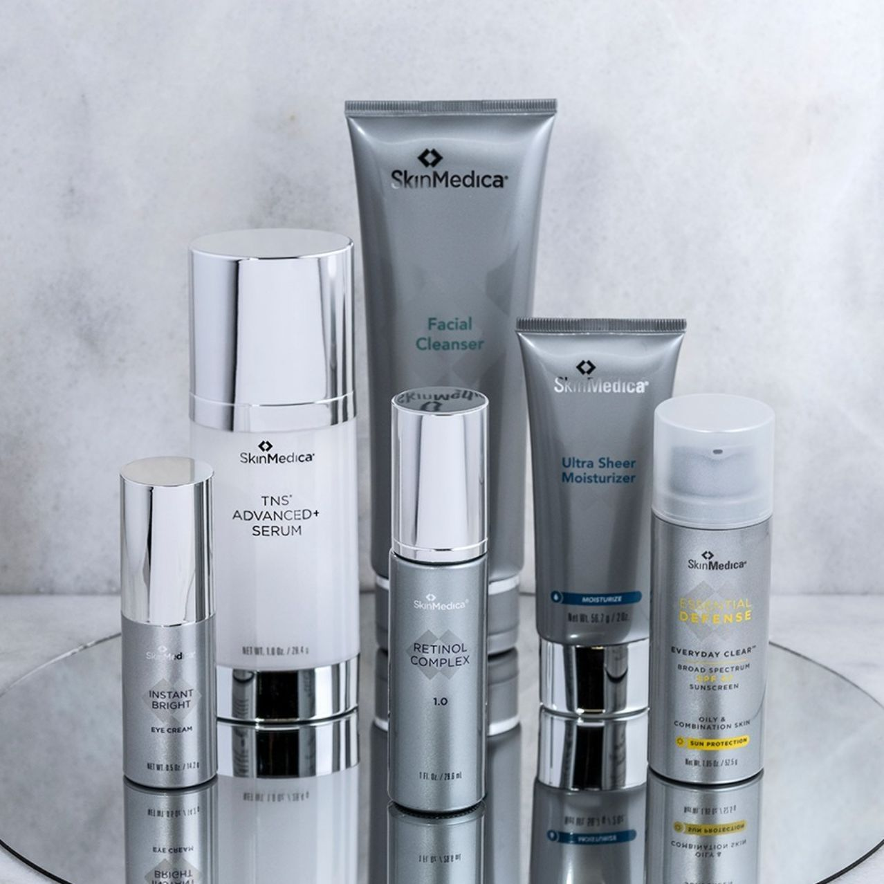 cosmetic products on mirror table