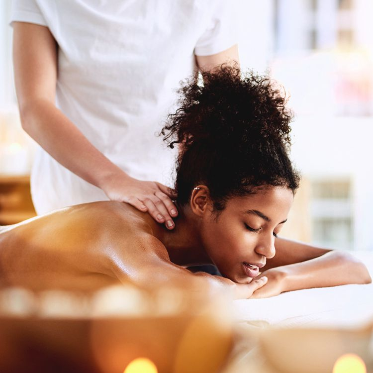 person gets massage at spa