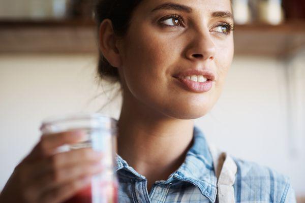 woman drinking a fresh juice