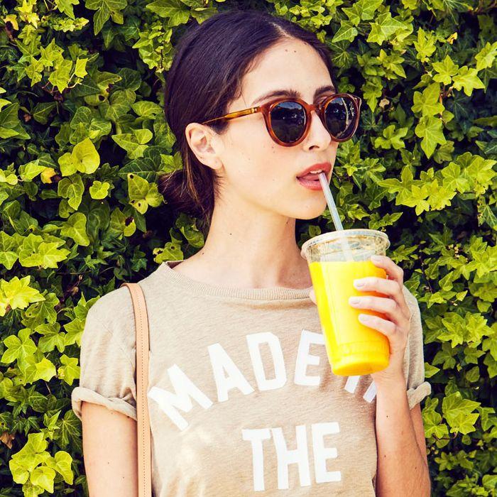 Healthy fast food breakfast: woman drinking orange juice