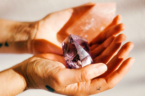 Hands holding crystals
