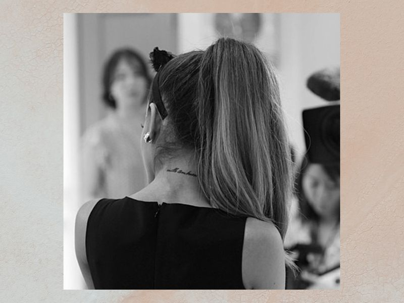 Ariana Grande from the back, neck tattoo visible