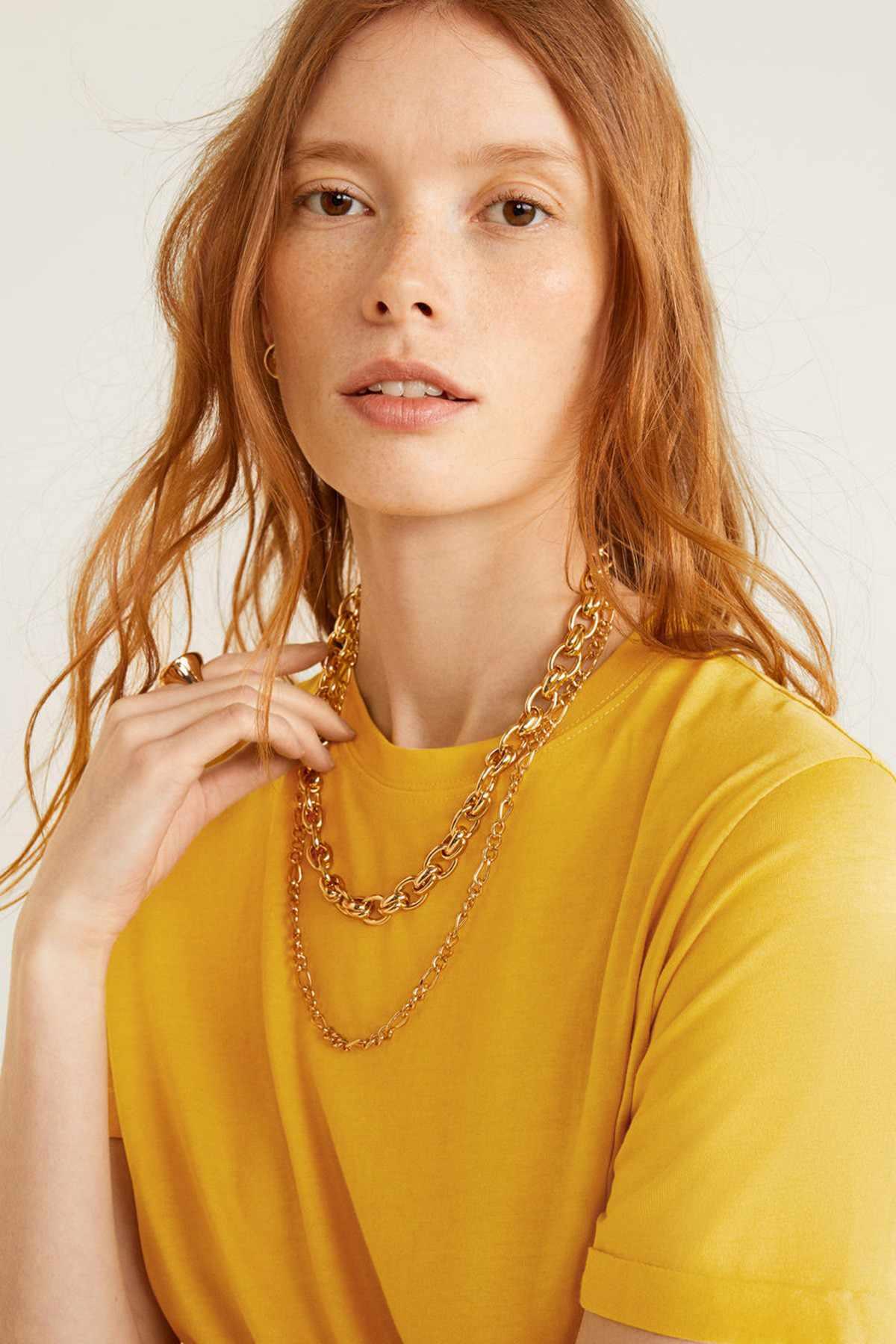 Women in mustard yellow top