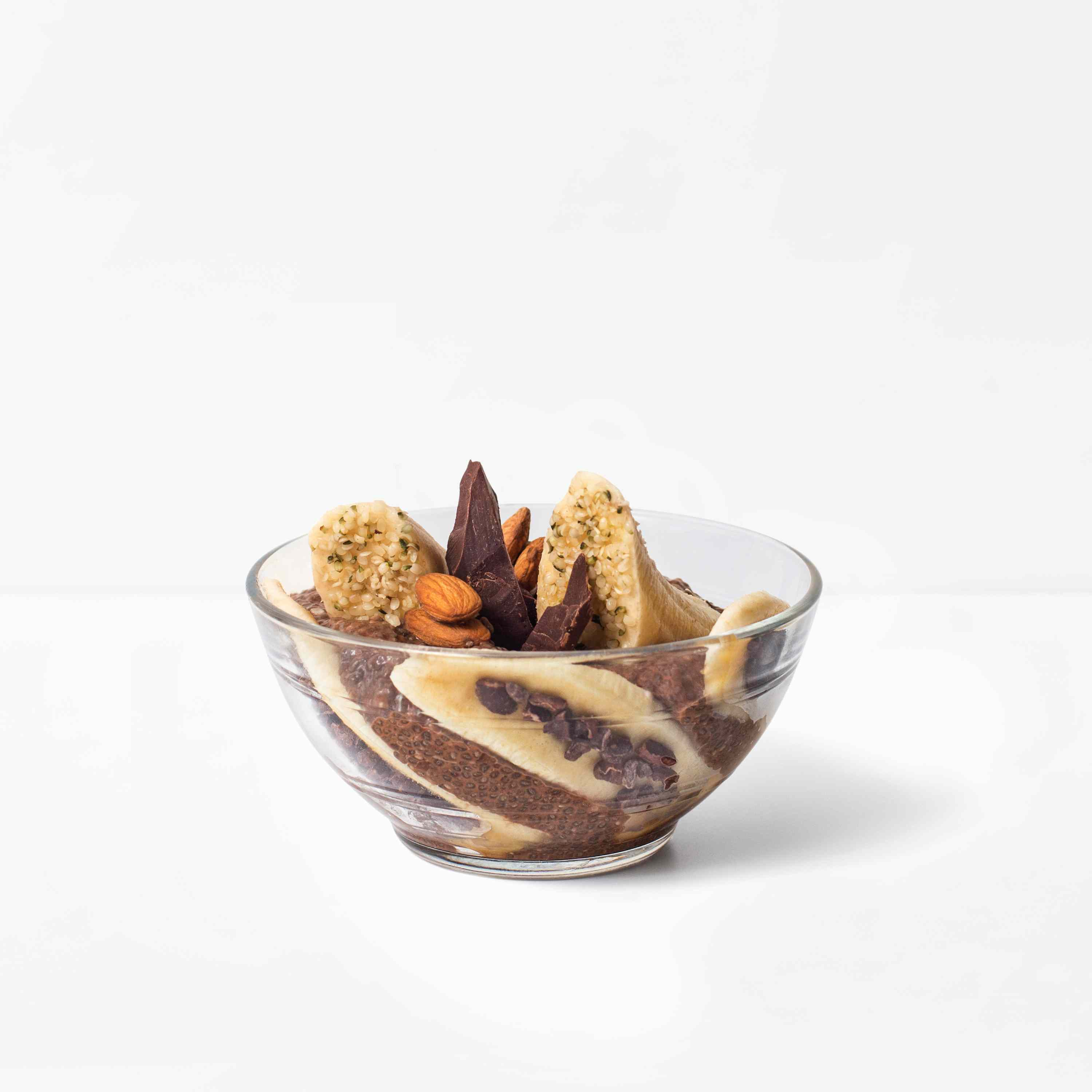 A chocolate protein and almond chia bowl presented in a glass dish