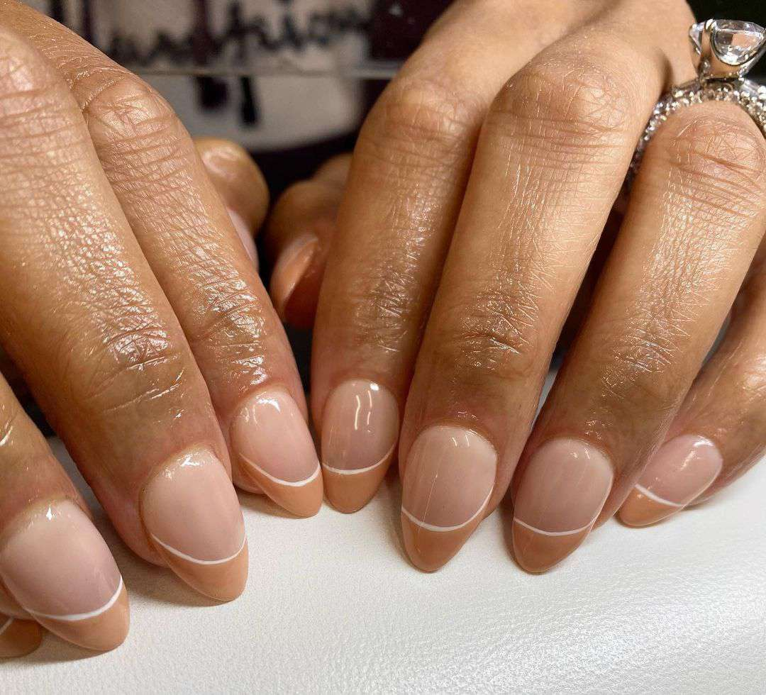 Person with toffee-tinted French tips.