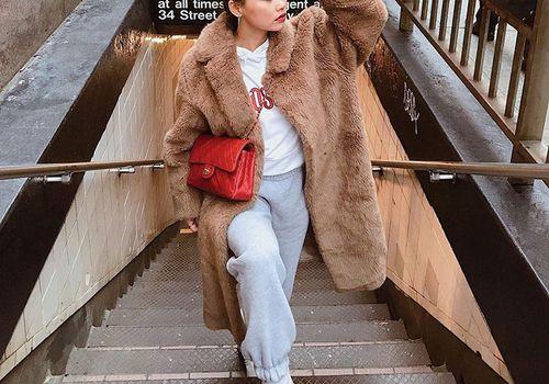 women in teddy bear coat