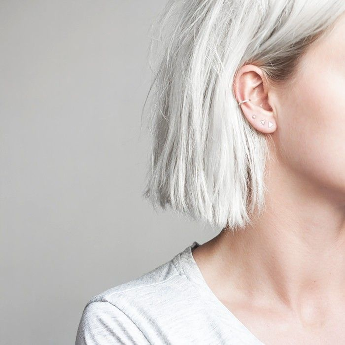 Woman with ultra-dainty ear piercings