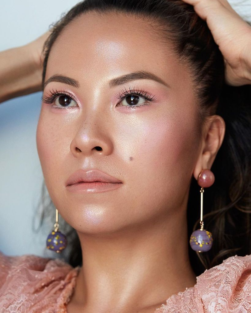 Nam Vo with pink eyeshadow and gleaming skin