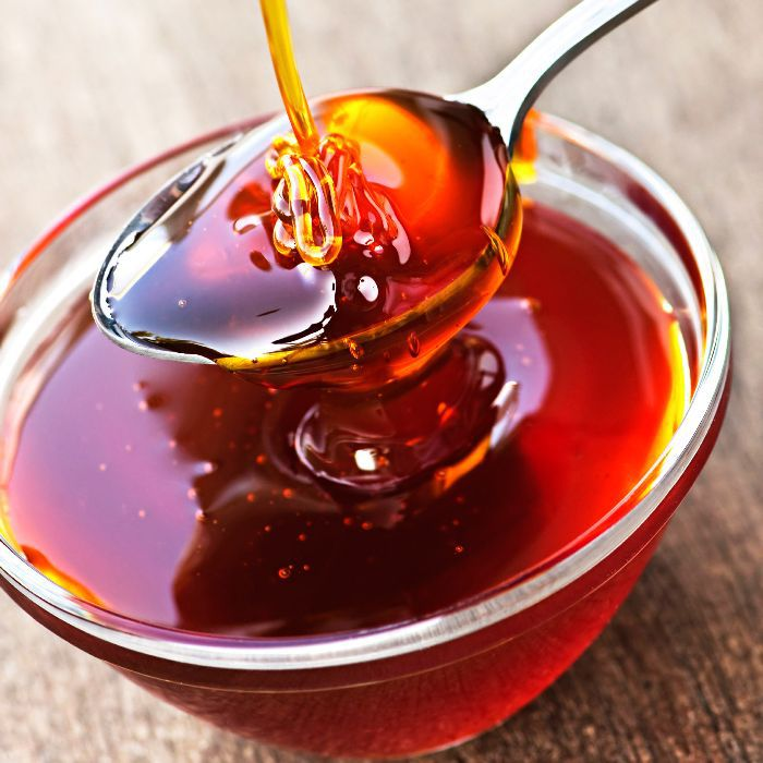 Small glass bowl of maple syrup