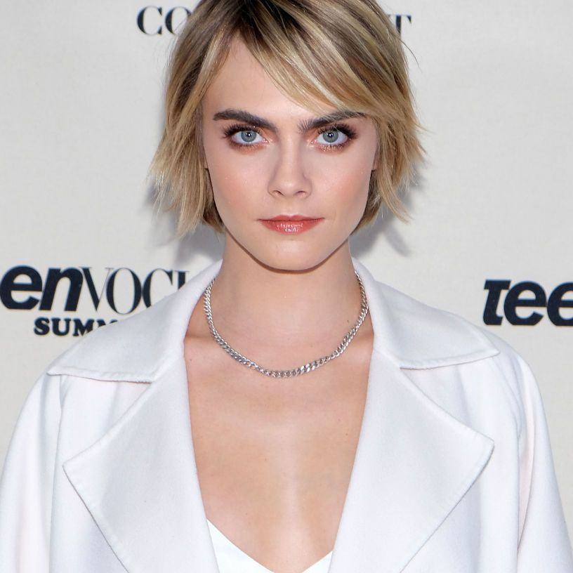 Cara Delevingne with a shaggy bob and side-swept bangs