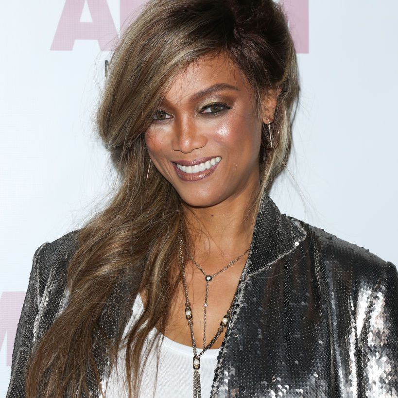 Tyra Banks side-parted long hair