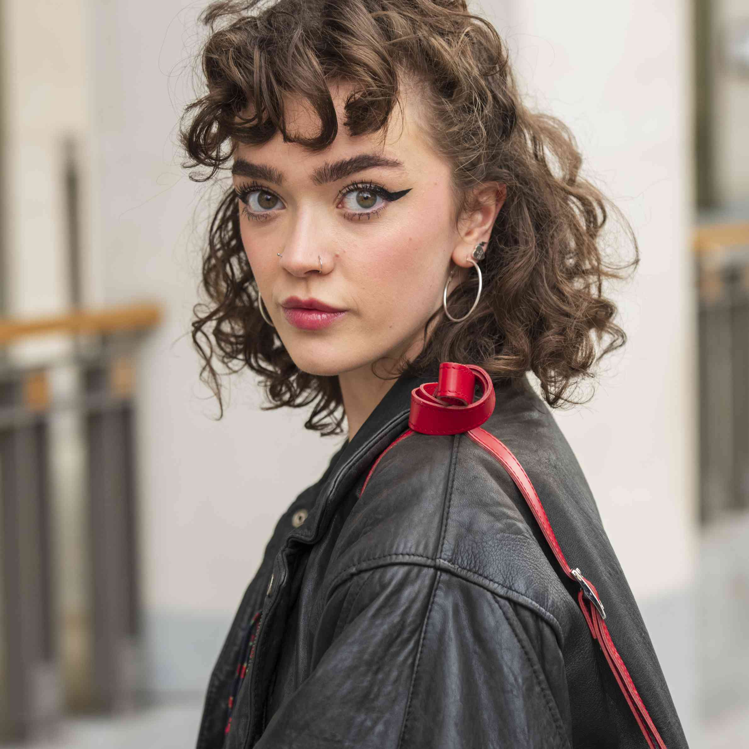 curly hairstyles: model with a top knot