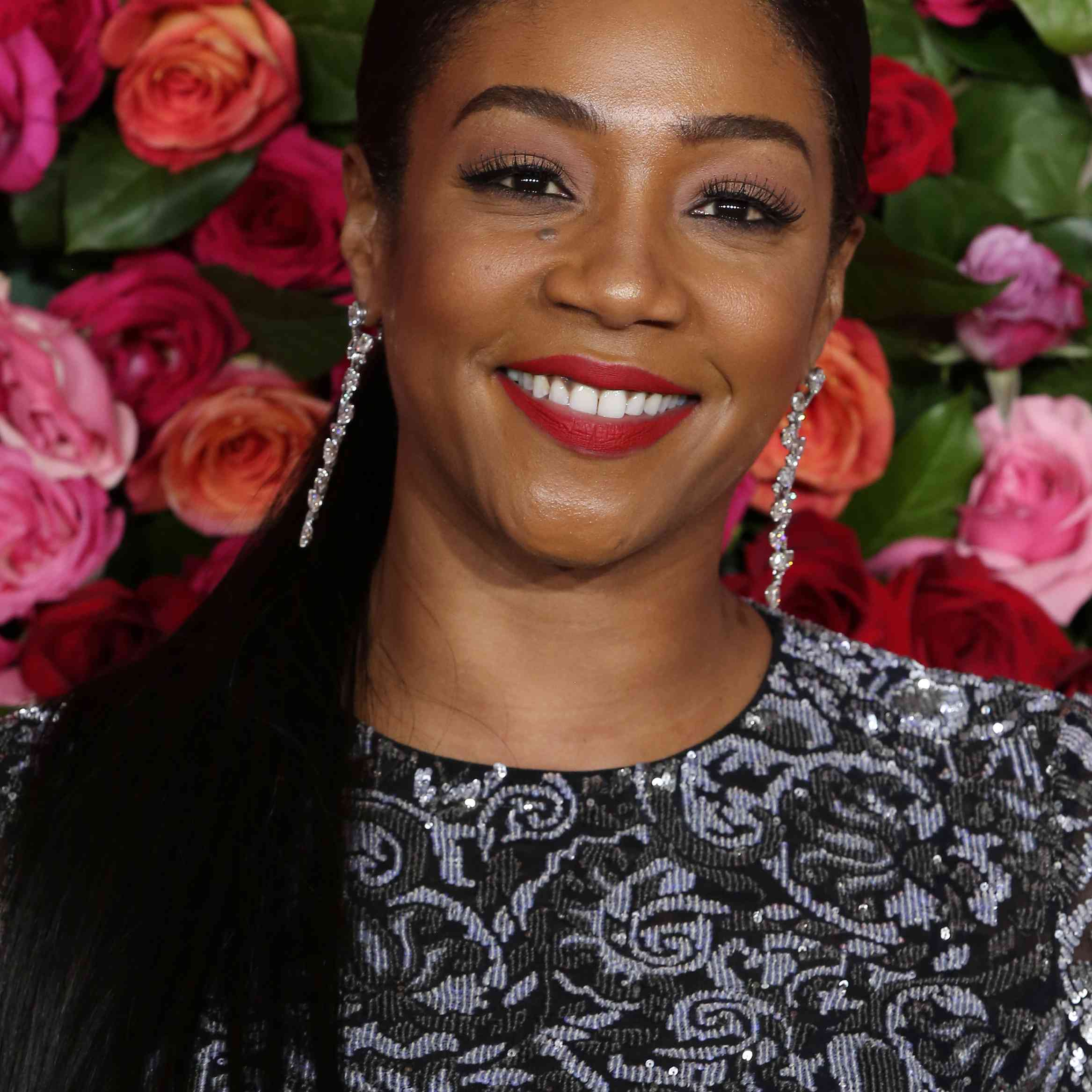 Tiffany Haddish with a parted ponytail