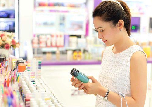 Woman shopping beauty aisle