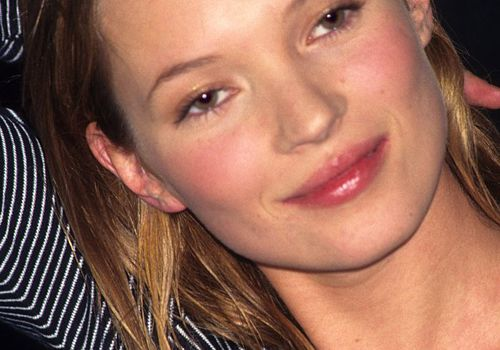 '90s beauty looks: Kate Moss with minimal makeup and striped top