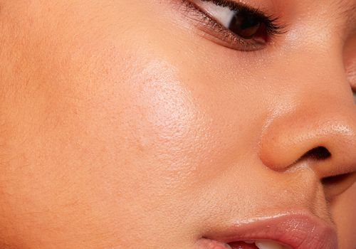 Close-up of a young woman's face in partial profile