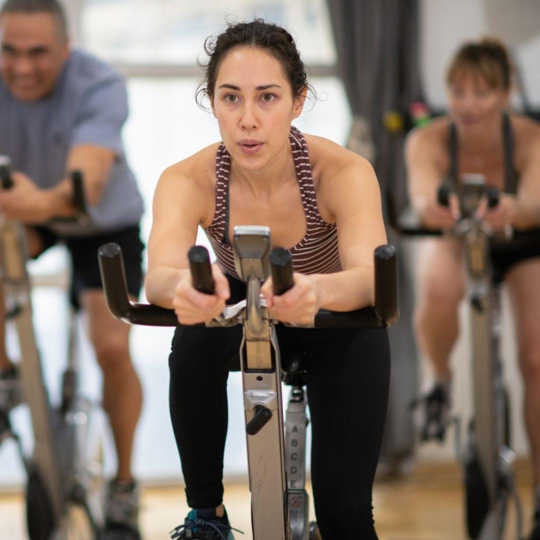 Woman riding bike in class