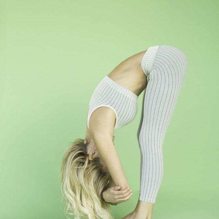 Woman in standing-forward fold pose