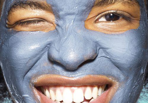 woman wearing blue face mask
