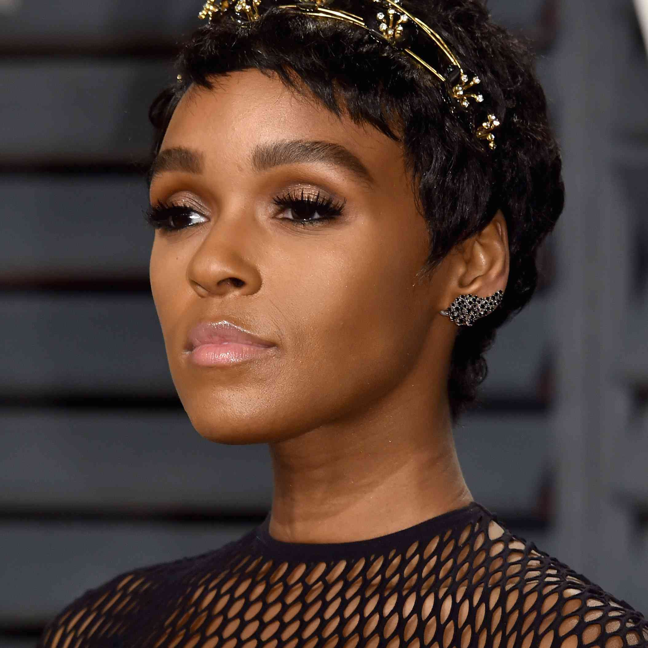 Janelle Monae pixie cut with a headband