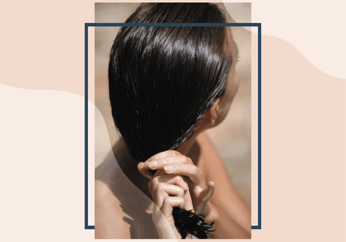 woman ringing out hair