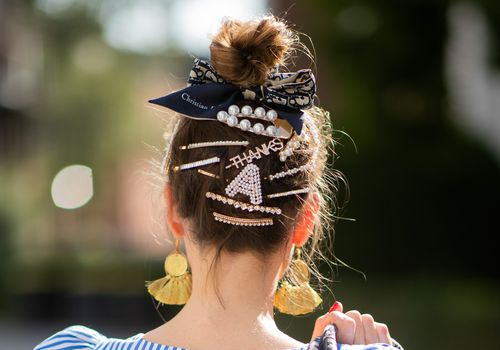 woman wearing bun with clips and a bow