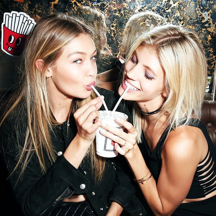 Models Gigi Hadid and Devon Windsor sharing a milkshake