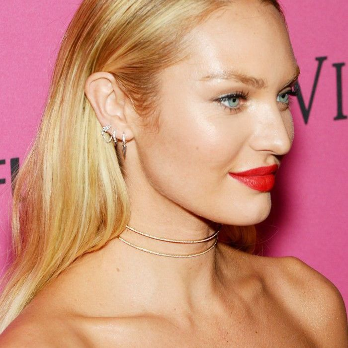 Candice Swanepoel slicked-back hair and red lips