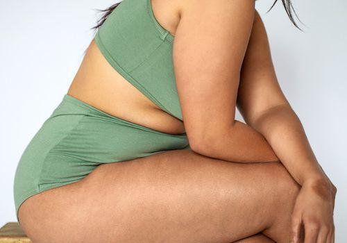 Plus size woman wearing green lingerie/loungewear