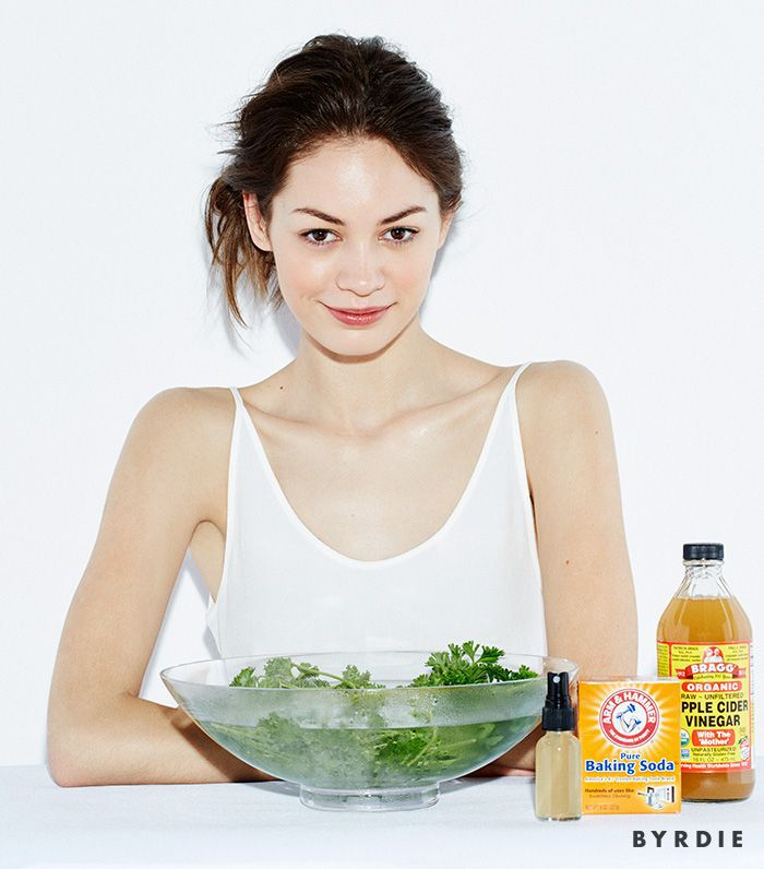 model with bowl of herbs in water, baking soda, apple cider vinegar, and a spray bottle