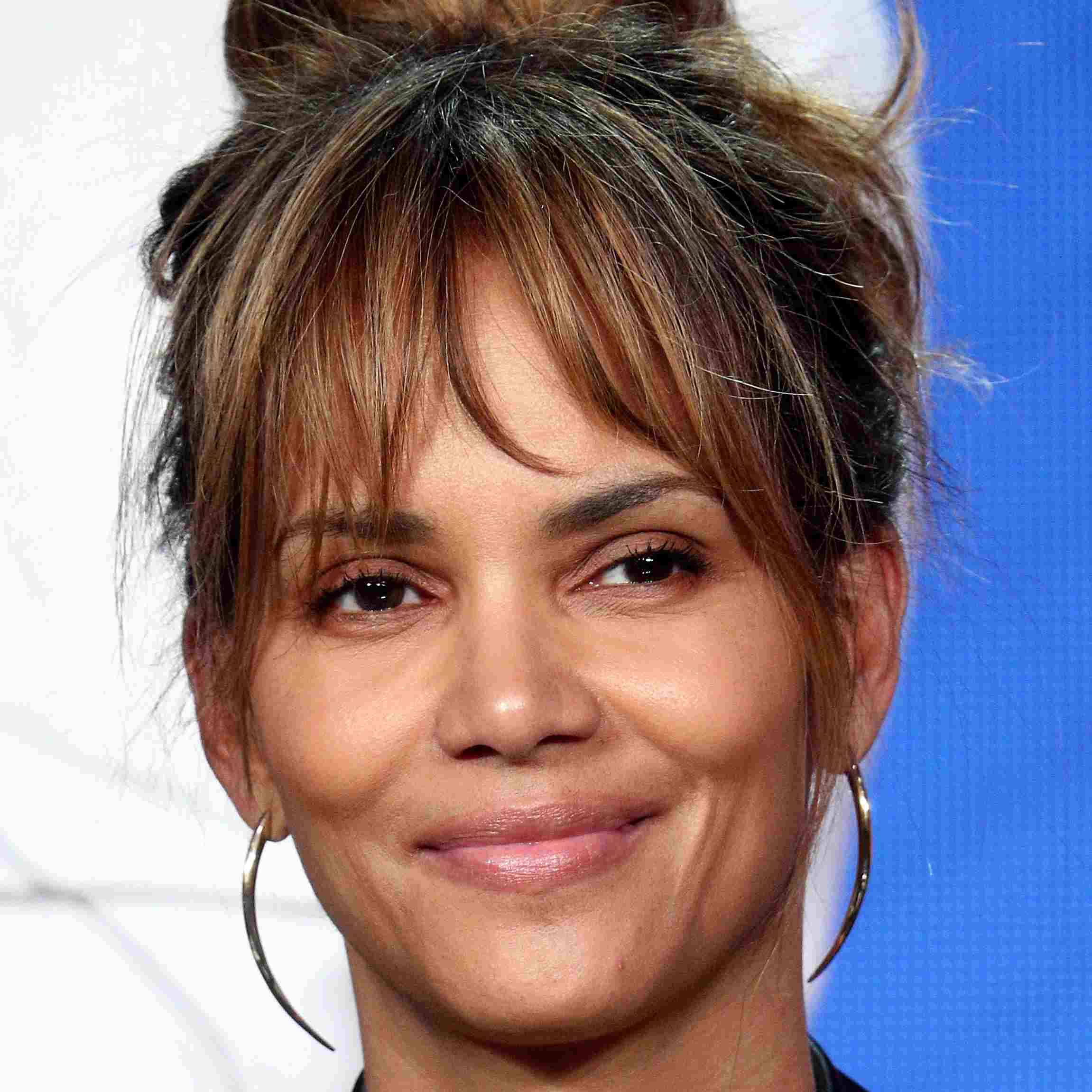 Halle Berry with a topknot and bangs