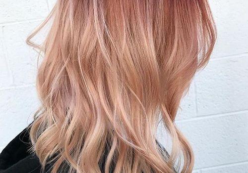 copper hair colours: model with peach hair